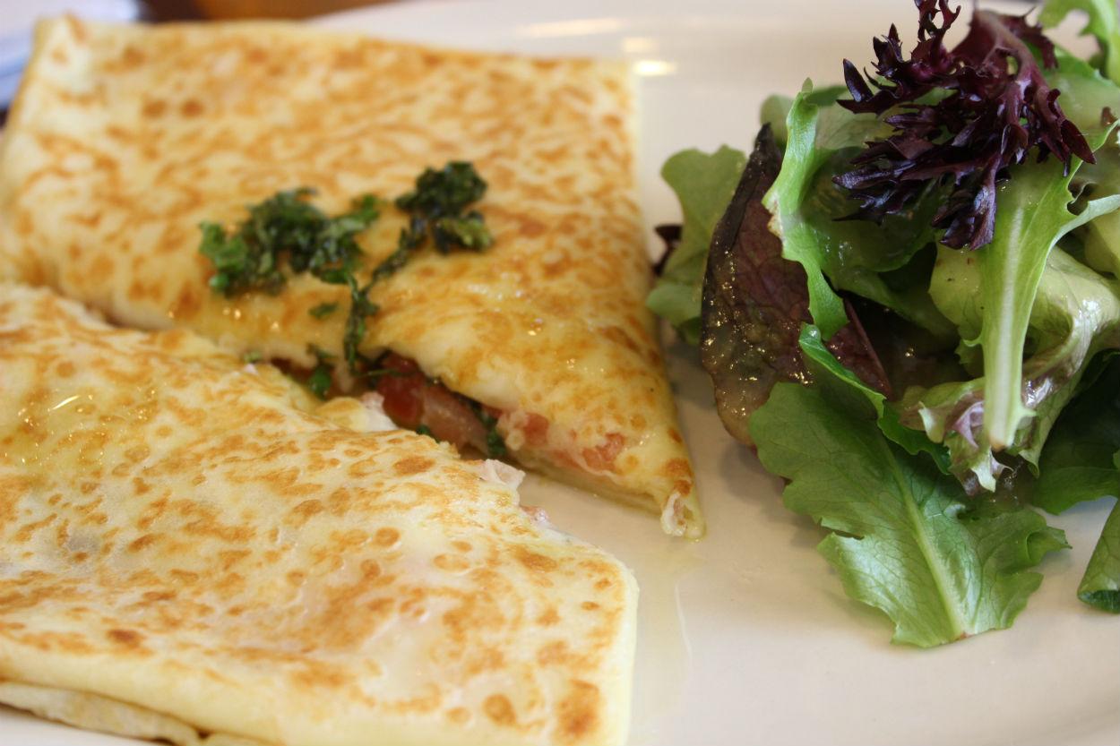 Caprese: mozzarella cheese, tomato, basil, mornay sauce & side salad.